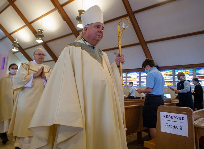 Philadelphia Archbishop Nelson Perez, passes eighth grade students during the Recessional at St. Charles Borromeo School's 100th anniversary Mass, held Wednesday, Sept. 30, 2020.