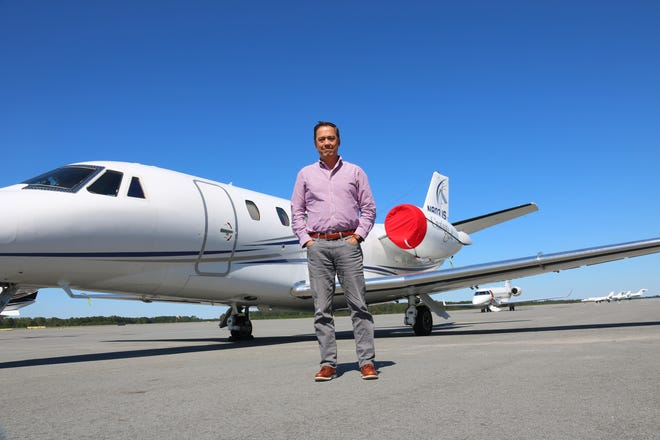 flyExclusive Chief Operating Officer Donn Yates poses in front of a Cessna Citation Excel business jet Wednesday, Sept. 30, at the North Carolina Global TransPark. [Brandon Davis/Kinston Free Press]