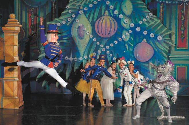 In this scene from The Nutcracker, the Nutcracker Prince fights The Mouse King, played by Jeremiah Isley of Tallmadge. Isley's brother Joshua, also from Tallmadge, also has performed in the ballet as Herr Drosselmeyer. The brothers have been involved in Ballet Theatre of Ohio's production of the holiday ballet since the first year.