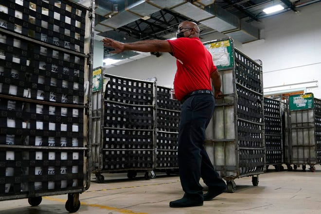 Employees load vote-by-mail ballots into a truck for transport to a local U.S. Postal Service office at the Broward Supervisor of Elections Office, Thursday, Sept. 24, 2020, in Lauderhill. Florida Democrats are building a substantial lead in mail-in ballot requests for November's presidential election, but questions remain about whether that will be a significant advantage for Joe Biden as he tries to wrest the nation's largest swing state from President Donald Trump.