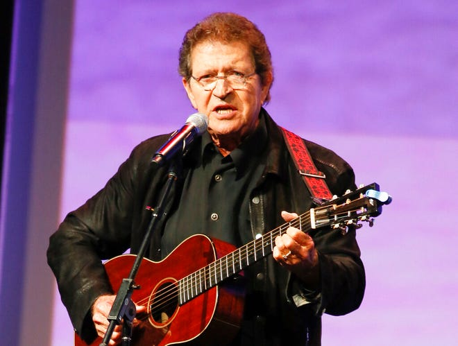 "Musician Mac Davis performs at the Texas Film Awards in Austin, Texas on March 6, 2014. Davis, a country star and Elvis songwriter, died on Tuesday, Sept. 29, 2020 after heart surgery. He was 78. Davis started his career writing hits for Presley, including ""A Little Less Conversation"" and ""In the Ghetto."" The Lubbock, Texas, native had a varied career over the years as a singer, actor and TV host and was inducted into the Songwriters Hall of Fame in 2006. He was named ACM entertainer of the year in 1974 after the success of songs like ""Baby Don't Get Hooked on Me."""