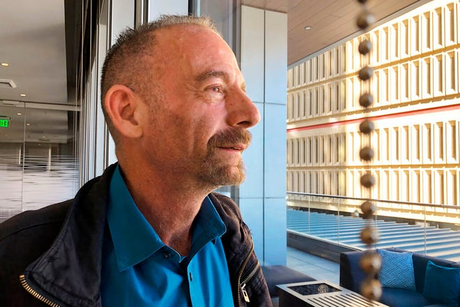 """FILE - This March 4, 2019, file photo shows Timothy Ray Brown in Seattle. Brown, who made history as """"the Berlin patient,"""" the first person known to be cured of HIV infection, died Tuesday, Sept. 29, 2020, at his home in Palm Springs, Calif., according to a social media post by his partner, Tim Hoeffgen. He was 54. The cause was a return of the cancer that originally prompted the unusual bone marrow and stem cell transplants Brown received in 2007 and 2008, which for years seemed to have eliminated both his leukemia and HIV, the virus that causes AIDS."""