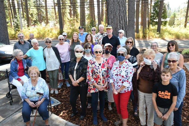 Angie Toreson's friends from her quilting and Bunko groups came together along with family members for the unveiling of a bench and memorial marker made for her daughter, Robin Toreson Hickman, who passed away in May. Many contributed to the garden and have added names of those who passed to a plaque in front of Scout Hall at Hoo Hoo Park in McCloud.
