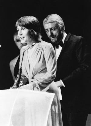 "In this March 3, 1973, file photo, Helen Reddy wins a Grammy Award for the best female song of the year for ""I Am Woman."" Reddy died at 78 on Sept. 29."