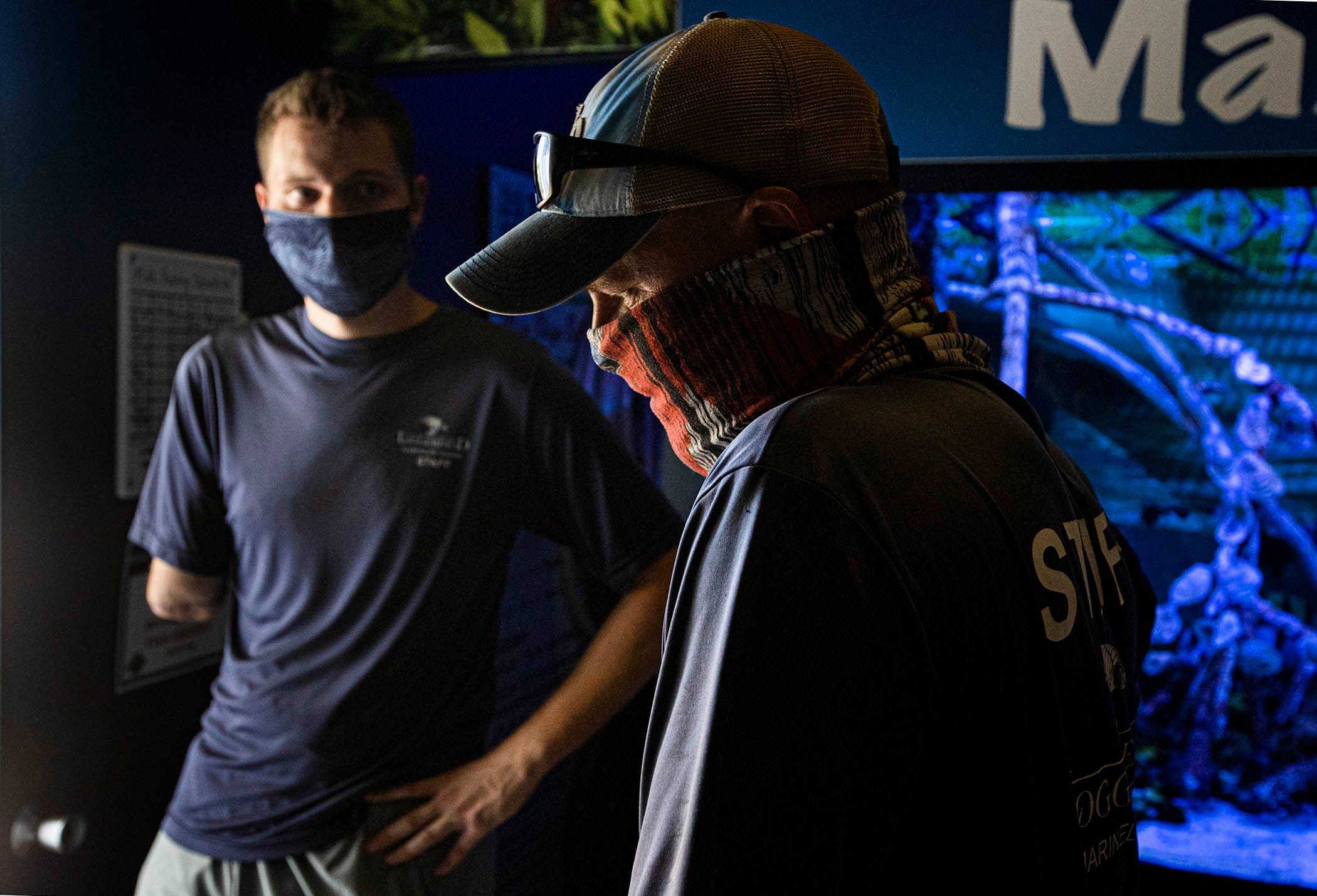 Andy Earl, right, and co-worker Carter Viss on Aug. 5 at Loggerhead Marinelife Center in Juno Beach.