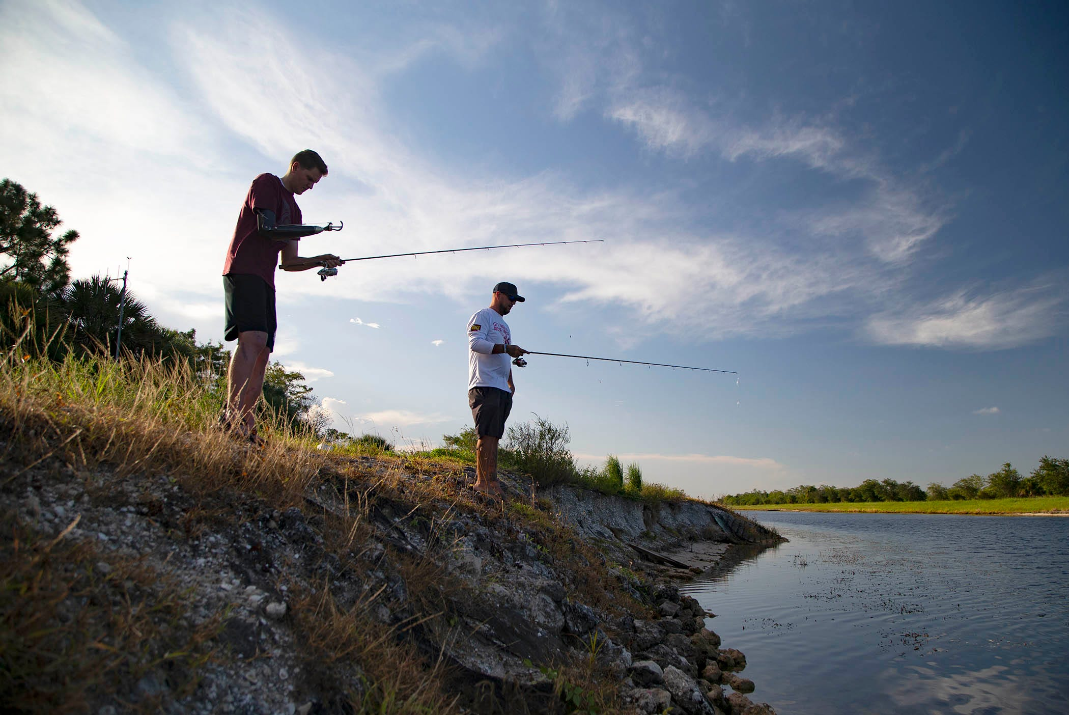 Carter Viss fishes on Aug. 7 with his friend and rescuer, Andy Earl, at Sandhill Crane Access Park outside of Palm Beach Gardens.