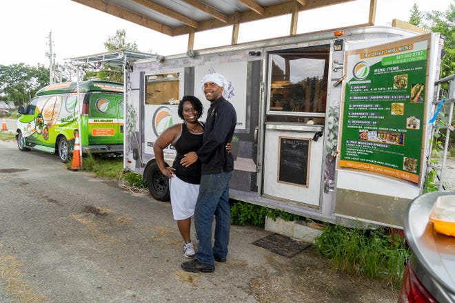 Patricia Jones and her husband Rahein Jones, owners of The New Vegan restaurant in Delray Beach, operate a drive-through vegan food truck on a patch of western Lake Worth farmland. (Greg Lovett/palmbeachpost.com)