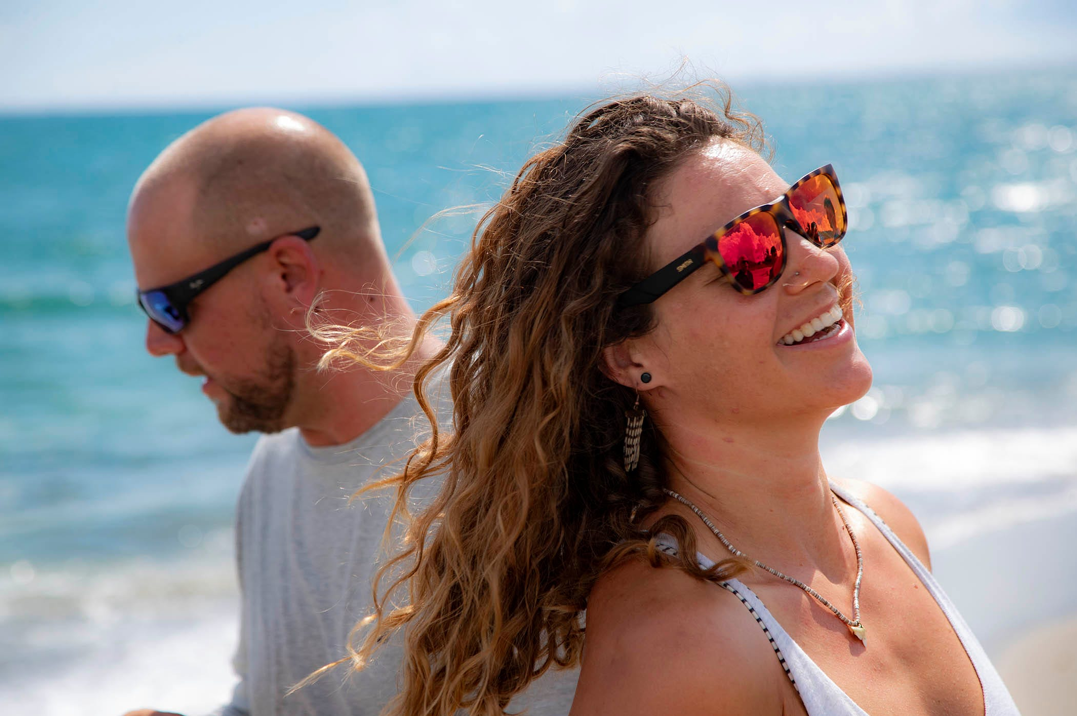 Christine Raininger, right, and Andy Earl helped save Carter Viss' life when the marine biologist was hit by a boat in the ocean last Thanksgiving Day. Viss was snorkeling near The Breaker's Reef when a boat severed his arm and damaged all of his limbs. Earl kept Viss afloat and Raininger tied a tourniquet after Viss watched his arm fall to the bottom of the sea.