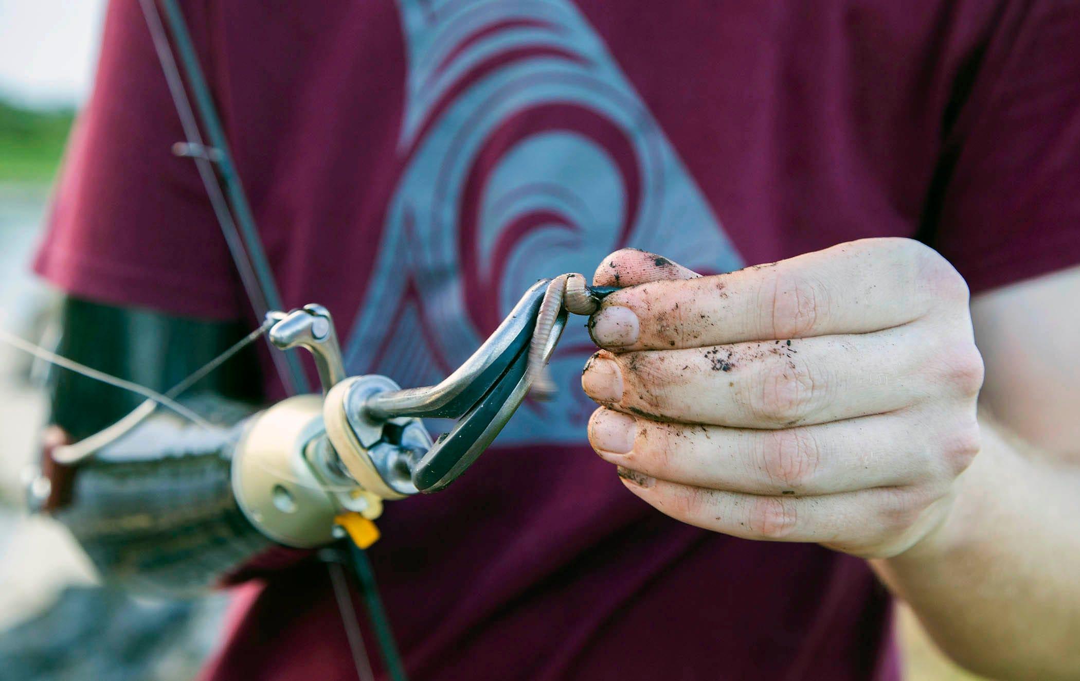 Carter Viss baits his hook Aug. 7 at Sandhill Crane Access Park.