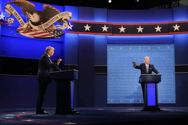 President Donald Trump, left, and Democratic presidential candidate former Vice President Joe Biden, right, gesturing during the first presidential debate on Tuesday at Case Western University and Cleveland Clinic, in Cleveland, Ohio. [AP Photo/Julio Cortez]