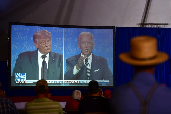 Viewers look on at the first presidential debate between President Donald Trump and Joe Biden, during a watch party in Lititz, Pa., Tuesday, Sept. 29, 2020. (Mark Makela/The New York Times)