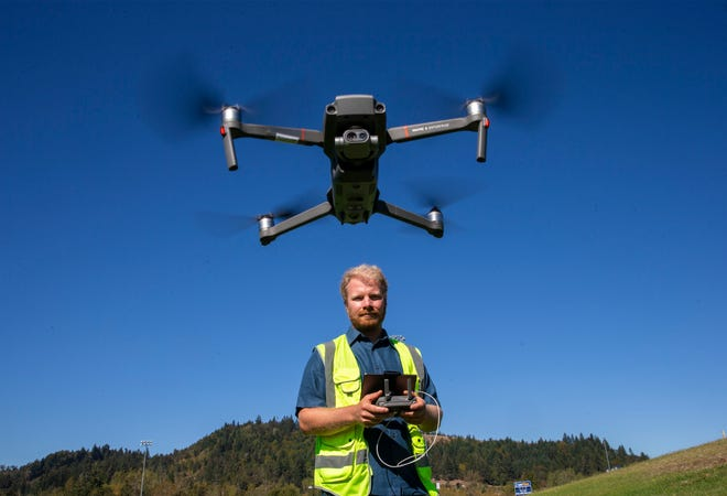 LCC instructor Solomon Singer, shown flying his drone in Eugene, got emergency clearance to fly over the Holiday Farm Fire in the early days of it burning to help identify hot spots. The drone can fly in thick smoke, unlike manned aircraft.