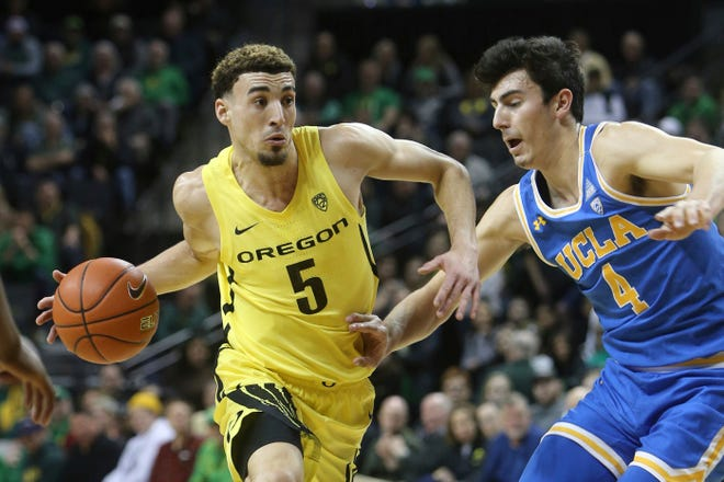 Chris Duarte (5) is Oregon's top returning scorer (12.9 points per game) and rebounder (5.6) from last season. He's seen here driving against UCLA's Jaime Jaquez Jr. during a Jan. 26 game at Matthew Knight Arena.
