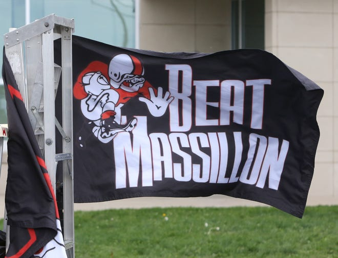"A ""Beat Massillon"" flag is flown during a parade hosted by Canton City Schools to support the McKinley High School football team as part of its McKinley-Massillon rivalry week festivities Wednesday, Sept. 30, 2020."