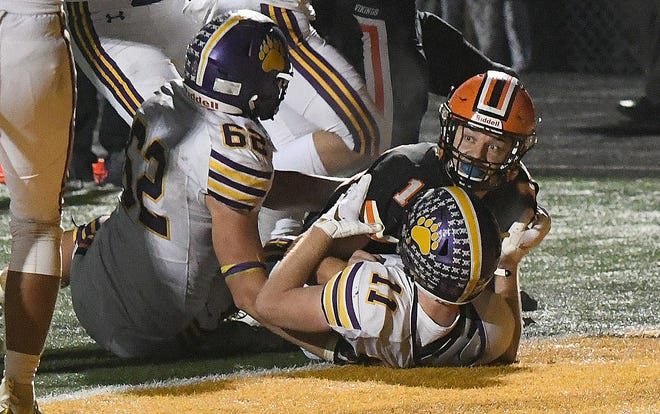 Hoover running back Adam Griguolo looks for the touchdown call that did not come as Jackson defenders Brett Blauner (11) and Joe Ackerman make the stop in the final seconds of last year's game at Memorial Stadium. Nov. 1, 2019.   (CantonRep.com / Ray Stewart)