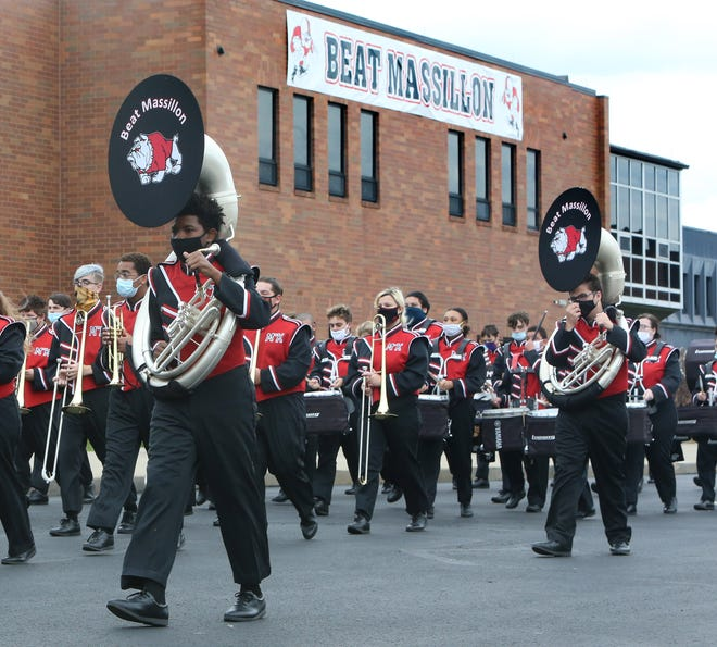 The McKinley High School marching band performed Wednesday during a caravan and band show to support the McKinley football team as part of McKinley-Massillon rivalry week festivities.