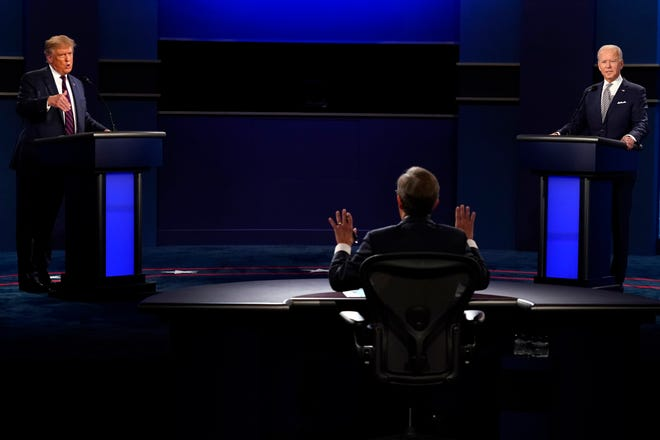 Moderator Chris Wallace of Fox News speaks as President Donald Trump and Democratic candidate former Vice President Joe Biden speak during the first presidential debate Tuesday, Sept. 29, 2020, at Case Western University and Cleveland Clinic, in Cleveland, Ohio. (AP Photo/Patrick Semansky)