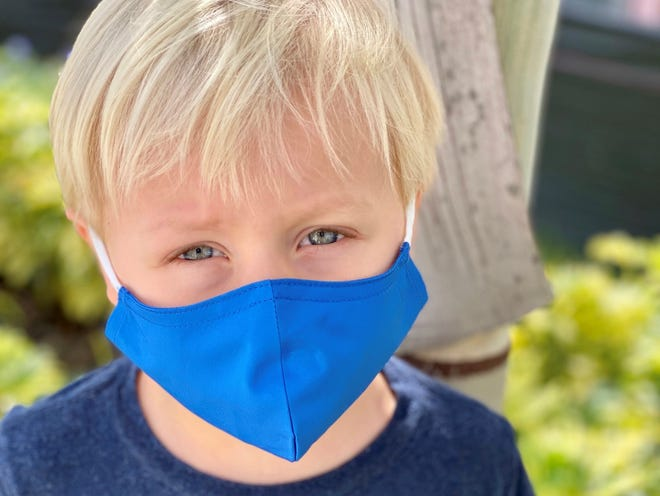 A child wearing a mask during the COVID-19 pandemic.