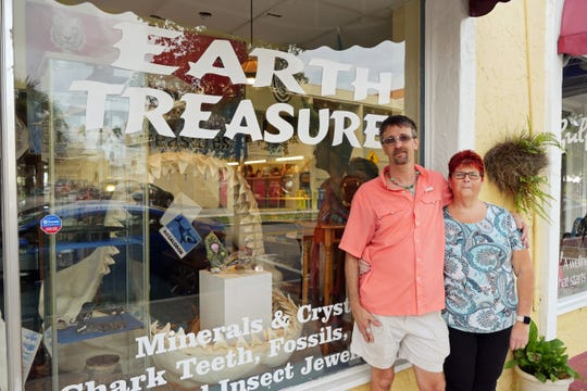 Don and Draeanne Rivette pose in front of their shop, Earth Treasures, on Miami Avenue.
