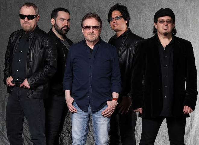 "Blue Oyster Cult, with singer-guitarist Donald ""Buck Dharma"" Roeser, center, will release ""The Symbol Remains,"" their first studio album in almost 20 years, on Friday."