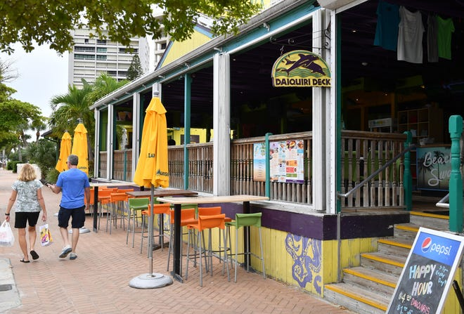 Daiquiri Deck, on Ocean Boulevard, is one of many popular businesses in Siesta Village enjoyed by tourists and residents.