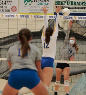 Out-of-Door Academy's Shelby Fulton goes for a kill against Charlotte High on Tuesday night at Wally Keller Gym in Punta Gorda.