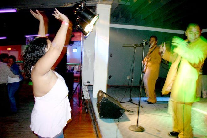 A patron of El Scorpion dances to a live band at the Wilmington club in 2005.