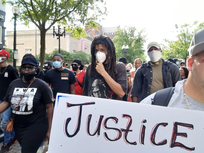 Rapper J. Cole takes part in a Black Lives Matter protest on May 30 in downtown Fayetteville.
