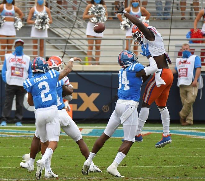Florida linebacker Brenton Cox Jr. (1) blocks a pass by Mississippi quarterback Matt Corral during the first half Saturday in Oxford, Miss.