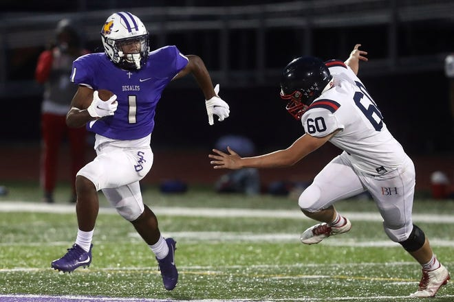 DeSales' Jordon Johnson escapes from Hartley's Joseph Ferryman during their game Sept. 11. The host Stallions won 24-21.