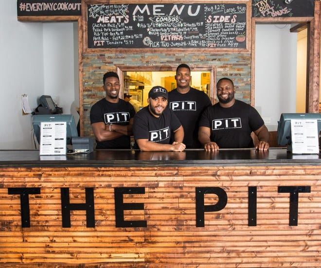 The owners of the Pit BBQ Grille, from left, Chimdi Chekwa, Mike Johnson, Bryant Browning and D'Andre Martin, hope to open their third restaurant in central Ohio in mid-October at 4219 N. High St. in Clintonville.