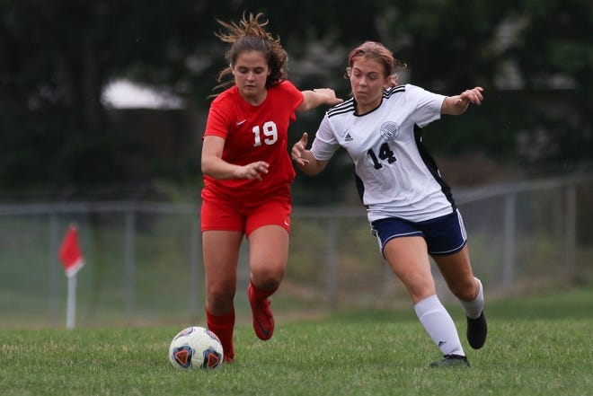 Centennial's Amelia Harris (left) and Whetstone's Ella Norris compete for possession of the ball during their game Sept. 23. The Stars and Braves are among four City League girls soccer programs this fall, joining Northland and West.
