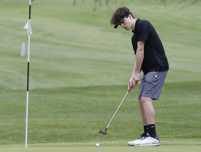 Ready's Westen Avery putts on the seventh green during the CCL  postseason tournament Sept. 27 at Denison Golf Club. The Silver Knights compete in a Division II sectional Oct. 1 at Turnberry.