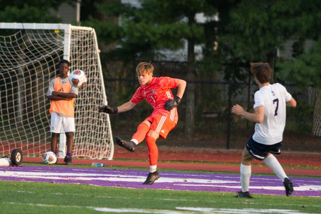 DeSales boys soccer goalkeeper Gabe Weikert, center, hopes to finish his career with a run at another Division II state championship despite the young Stallions' struggles to date. (Photo courtesy Barb Dougherty)