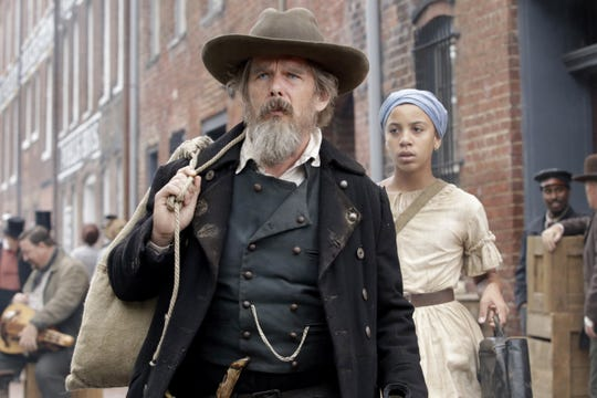 "Ethan Hawke as John Brown and Joshua Caleb Johnson as Onion in ""The Good Lord Bird."""