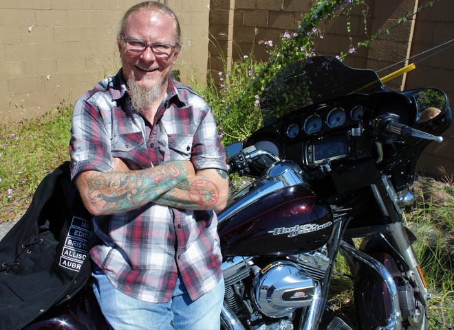 "Frank Pain with his Harley-Davidson Street Glide, which took him 2,300 miles recently across Texas and Oklahoma on his fund-raisnig effort called ""The Ride for Change."""