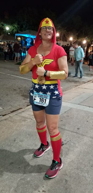 Michelle Anderson Ryan's friends call her Wonder Woman. On Oct. 9, they will run for 24 hours to encourage her as she continues treatment for lung cancer.