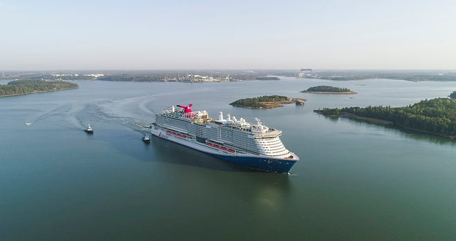 """Carnival Cruise Line's new Mardi Gras departs on its """"sea trials"""" from the Meyer Turku shipyard in Turku, Finland. The ship is scheduled to start sailing out of Port Canaveral in 2021."""