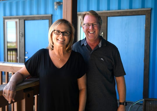 "Island Joe's owners Brenda Tumlinson, left, and Bryan Tumlinson stand in their coffeeshop, Tuesday, Sept. 29, 2020. The owners say the response to the promotion has been ""overwhelming."""