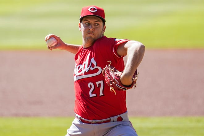 Sep 30, 2020; Cumberland, Georgia, USA; Cincinnati Reds starting pitcher Trevor Bauer (27) pitches against the Atlanta Braves during the first inning at Truist Park. Mandatory Credit: Dale Zanine-USA TODAY Sports
