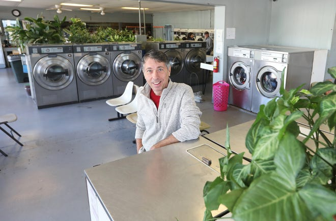 Athan Vlahos owns Nikko's Services in Coshocton. Nikko's includes dry cleaning and limo services, as well as a laundromat, which is brought to life by dozens of plants, including a 40-year-old palm tree.