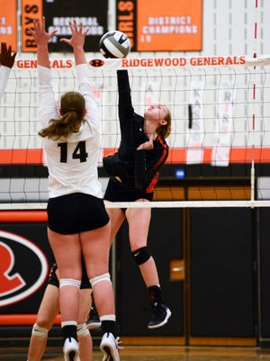 Hannah Maust spikes the ball for Ridgewood against visiting Hiland in a match earlier this season. Maust made first team All-IVC.