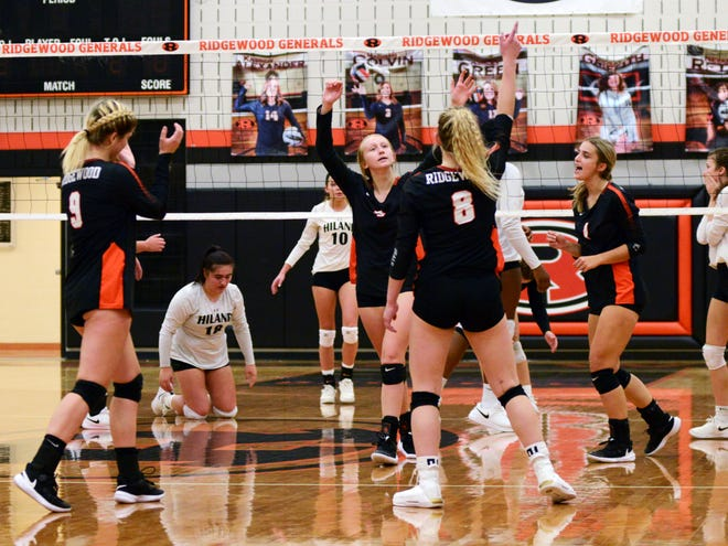 Ridgewood celebrates a point against visiting Hiland on Tuesday in West Lafayette.