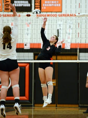Ridgewood's Madisyn Colvin plays the ball at the net against visiting Hiland during match during the 2020 season. Colvin signed with Wheeling University last week.