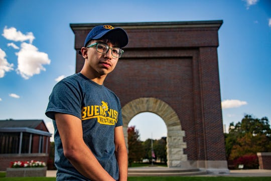 Diego Aguilera, a freshman wrestler at Buena Vista University, stands for a photo on campus Wednesday, Sept. 30, 2020. Aguilera is credited with saving a co-worker's life on his first day of work at Walmart earlier this month.