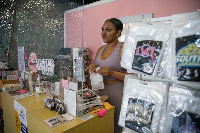 Tauntus Cosmetics and Beauty Bar manager Gabrielle White works at the Livernois Avenue store on Sept. 23, 2020. Many shops along Livernois Avenue near Seven Mile in Detroit are clawing back from first, road construction and second, the pandemic.