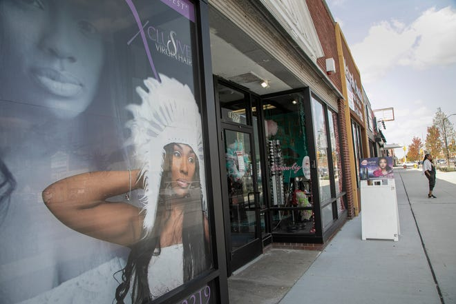 Tauntus Cosmetics and Beauty Bar exterior at the Livernois Avenue store on Sept. 23, 2020. Many shops along Livernois Avenue near Seven Mile in Detroit are clawing back from first, road construction and second, the pandemic.