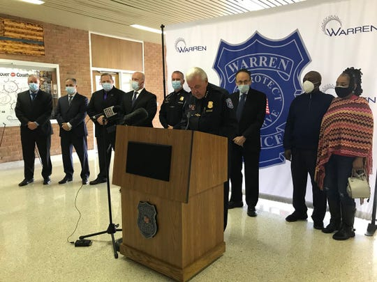 Warren Police Commissioner Bill Dwyer at a press conference Wednesday afternoon announcing charges against a suspect in hate crimes in the city. Standing behind Dwyer to the right are Eddie and Candace Hall, the victims of the attacks.
