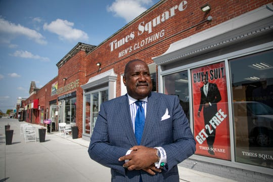 """Times Square owner Algernon Bartell poses outside of his shop on Sept. 23, 2020, on Livernois Avenue in Detroit. """"This area is destined to be the next Harlem,"""" said Bartell of the newly renovated Avenue of Fashion. Many shops along Livernois Avenue near Seven Mile are clawing back from first, road construction and second, the pandemic."""