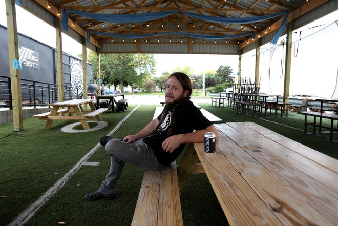 Stephen Roginson is the owner and founder of Batch Brewing on Porter Street in Detroit. On Sept. 29, 2020, Roginson was prepping his business for outside dining as cold weather is starting to come. Roginson has had an outdoor shelter built that will soon have plastic enclosures around the shelter and a large heater hung on the ceiling to keep the area warm for customers.